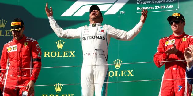 Formula One F1 - Hungarian Grand Prix - Hungaroring, Budapest, Hungary - July 29, 2018   Mercedes? Lewis Hamilton celebrates on the podium after winning the race alongside second placed Ferrari?s Sebastian Vettel and third placed Ferrari?s Kimi Raikkonen