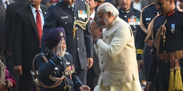NEW DELHI, INDIA - JANUARY 26: Prime Minister Narendra Modi greets Marshal of the Indian Air Force, Arjan Singh, during 'At Home' reception at President's House, on January 26, 2016 in New Delhi, India.