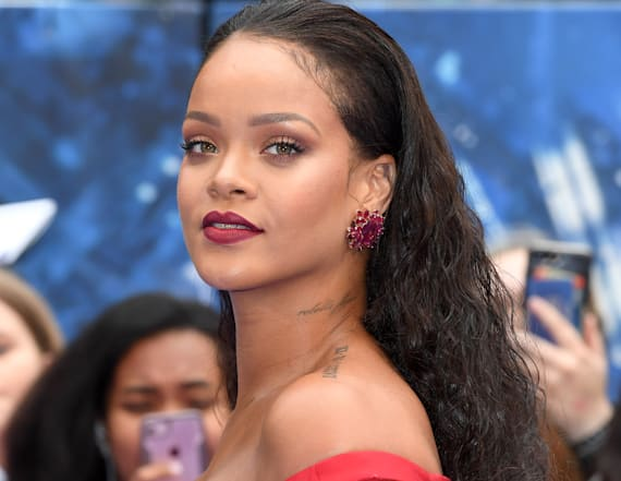 Rihanna dons cleavage-baring red gown
