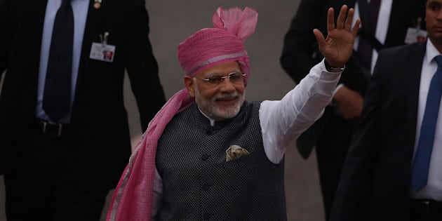 PM Narendra Modi waves towards the crowd as he leaves after attending the Republic Day parade in New Delhi on 26 January 2017.