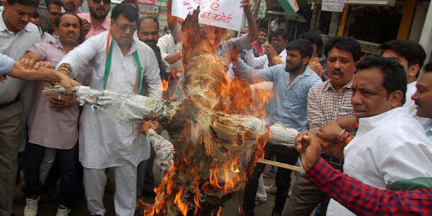 Demonstrators burn an effigy of Madhya Pradesh Chief Minister Shivraj Singh Chauhan at a protest organised by the Congress in Bhopal on 7 June 2017.