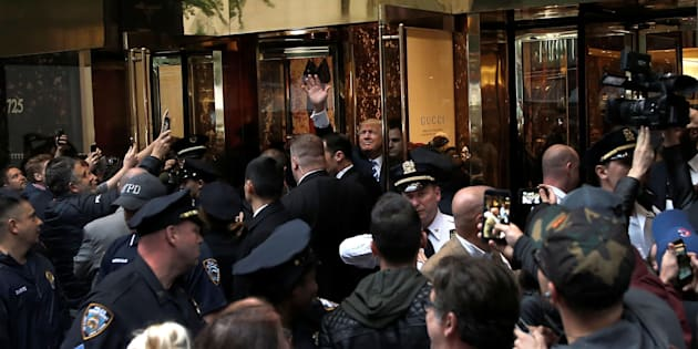 Donald Trump waves to supporters outside Trump Tower on Saturday.