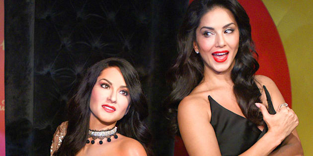 Leone with her wax figure in New Delhi on Tuesday.