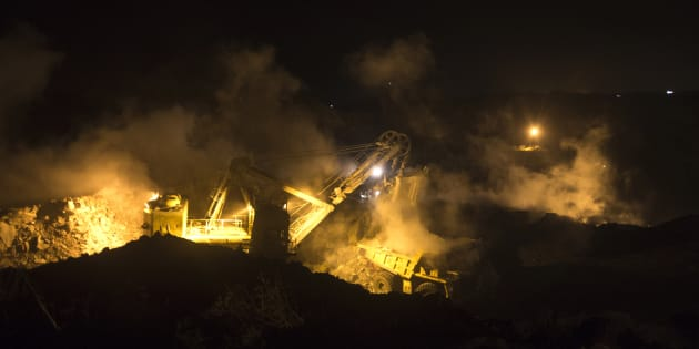 A truck is loaded with top soil at the Jharia burning coal field at Dhanbad district in the eastern Indian state of Jharkhand September 17, 2012.