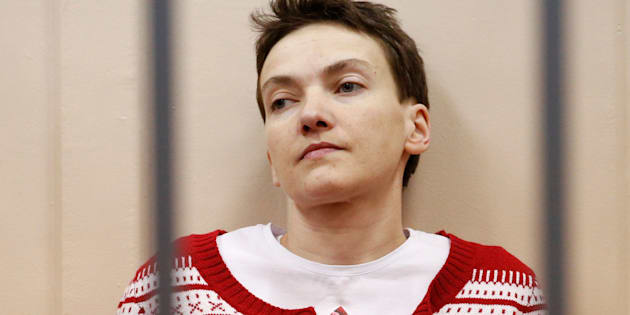 Ukrainian military pilot Nadezhda Savchenko looks out from a defendants' cage as she attends a court hearing in Moscow March 4, 2015.