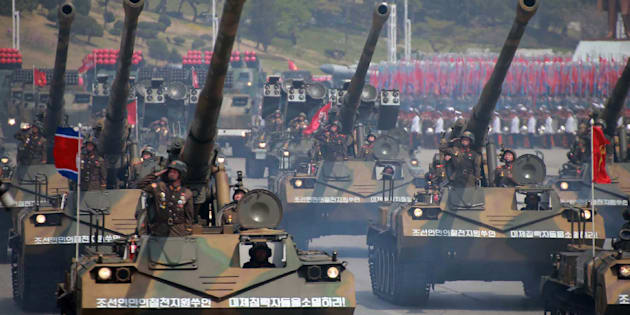 Korean People's howitzers are paraded through Kim Il-Sung square in Pyongyang.