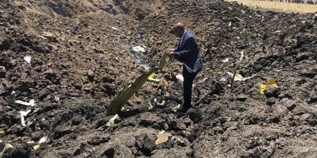 In this photo taken from the Ethiopian Airlines Facebook page, the CEO of Ethiopian Airlines, Tewolde Gebremariam, looks at the wreckage of the plane that crashed shortly after takeoff from Addis Ababa, Ethiopia on March 10, 2019.
