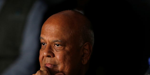 Former Finance Minister Pravin Gordhan reacts as African National Congress Youth League members interrupt a memorial service for anti-apartheid activist Ahmed Kathrada in Durban, South Africa, April 9, 2017. REUTERS/Rogan Ward