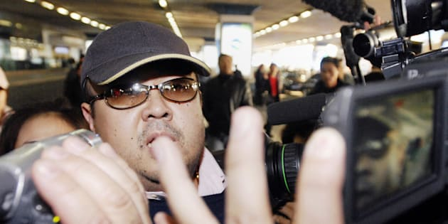 This photo taken on February 11, 2007 shows a man believed to be then-North Korean leader Kim Jong-Il's eldest son, Kim Jong-Nam, walking amongst journalists upon his arrival at Beijing's international airport.
