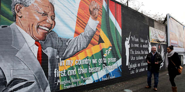 A mural to Nelson Mandela in west Belfast as First Minister Peter Robinson paid tribute to the former South African leader's humility and charisma following his death at the age of 95.
