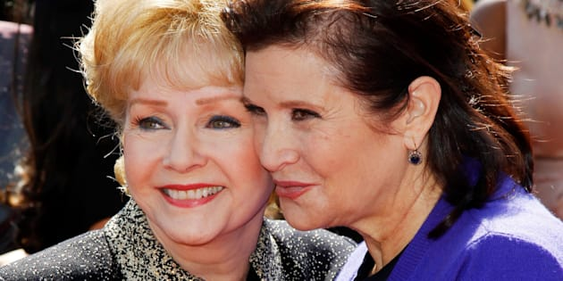 Debbie Reynolds, and her daughter Carrie Fisher, arrive at the 2011 Primetime Creative Arts Emmy Awards in LA, Sept.10, 2011.
