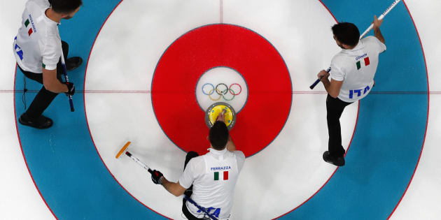 Curling - Pyeongchang 2018 Winter Olympics - Men?s Round Robin - Canada v Italy - Gangneung Curling Center - Gangneung, South Korea - February 14, 2018 - Daniele Ferrazza of Italy delivers a stone next to team mates Amos Mosaner and Simone Gonin. REUTERS/Cathal McNaughton