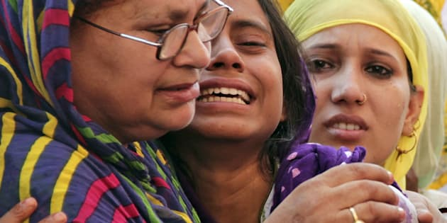 Relatives of Mohammad Akhlaq mourn after he was killed by a mob at his residence in Dadri town, in Uttar Pradesh.