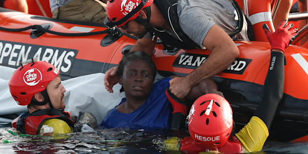 TOPSHOT - Members of the Spanish NGO Proactiva Open Arms rescue a woman in the Mediterranean open sea about 85 miles off the Libyan coast on July 17, 2018. (Photo by PAU BARRENA / AFP)        (Photo credit should read PAU BARRENA/AFP/Getty Images)