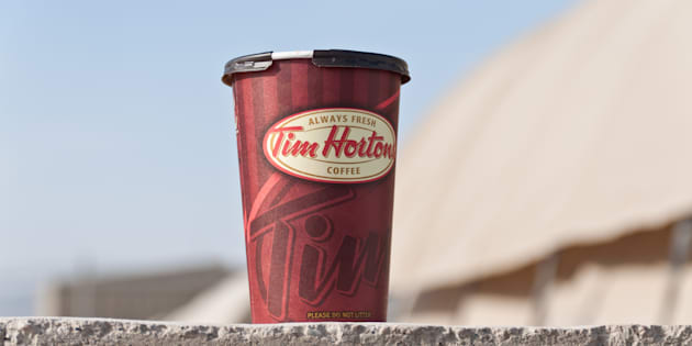 The parent company of Tim Hortons seized ownership of four locations from a restaurant owner heading an unsanctioned franchisee group after he allegedly leaked sensitive corporate news to the media.