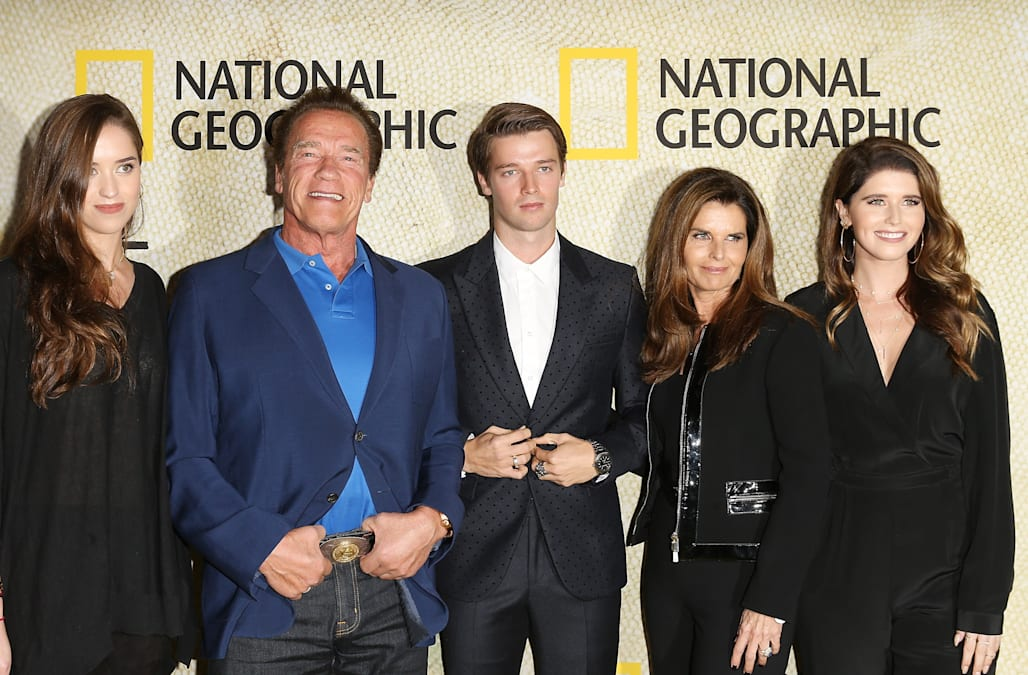 arnold schwarzenegger and ex maria shriver pose with three children on red carpet