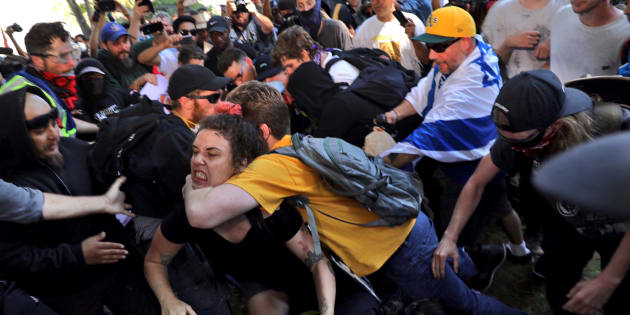 BERKELEY, CA - AUGUST 27: Fighting breaks out at Martin Luther King Park in Berkeley where counter protesters and Trump supporters clashed.(Photo by Marcus Yam/Los Angeles Times via Getty Images)