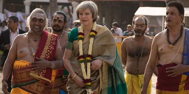 British Prime Minister Theresa May is welcomed to the Sri Someshwara Temple on November 8, 2016 in Bangalore, India.
