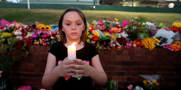 Ella Cowen attends a candlelit vigil outside Dreamworld on the Gold Coast, Queensland.