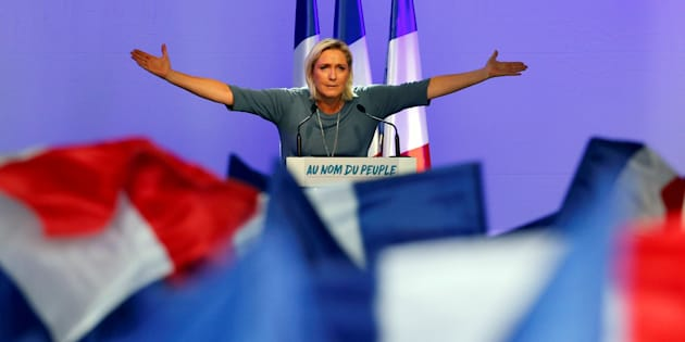 Marine Le Pen, French National Front (FN) political party leader, gestures during an FN political rally in Frejus, France, September 18, 2016.
