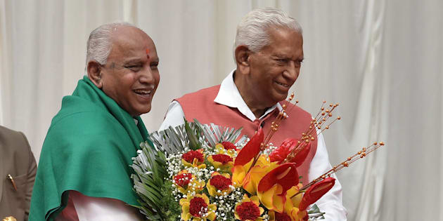 BENGALURU, INDIA - MAY 17: Governor of Karnataka Vajubhai Rudabhai Vala felicitates the Bharatiya Janata Party leader B. S. Yeddyurappa after the oath taking ceremony as the 23rd Chief Minister of Karnataka at Raj Bhawan on May 17, 2018 in Bengaluru, India. Yeddyurappa was sworn in as Karnataka?s new Chief Minister on Thursday morning after the Supreme Court refused to stay the oath-taking ceremony in a late-night hearing. (Photo by Arijit Sen/Hindustan Times via Getty Images)