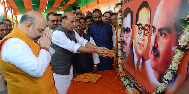 BJP National President Amit Shah and Union Home Minister Rajnath Singh paying floral tributes to the Portraits of Pandit DeenDayal Upadhyaya, Bhimrao Ambedkar and Shyama Prasad Mukherjee before party workers'convention at Gandhi Maidan on April 14, 2015 in Patna.