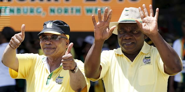 President Jacob Zuma (L), gestures next to deputy president Cyril Ramaphosa during the party's 104th-anniversary celebrations in Rustenburg. January 9, 2016.