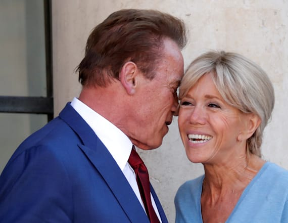 Schwarzenegger smooches French First Lady