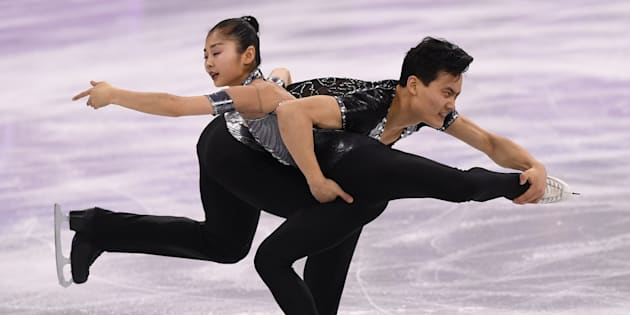 North Korea's Ryom Tae Ok and North Korea's Kim Ju Sik (R) compete in the pair skating short program of the figure skating event during the Pyeongchang 2018 Winter Olympic Games at the Gangneung Ice Arena in Gangneung on February 14, 2018. / AFP PHOTO / JUNG Yeon-Je        (Photo credit should read JUNG YEON-JE/AFP/Getty Images)