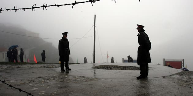 Chinese soldiers guard the Nathu La mountain pass, between Tibet and Sikkim.