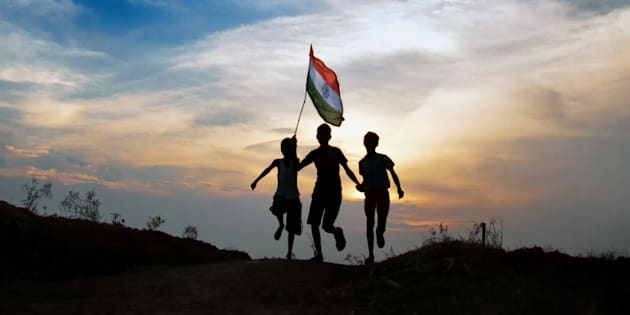 Boys running with indian flag in sunset time.