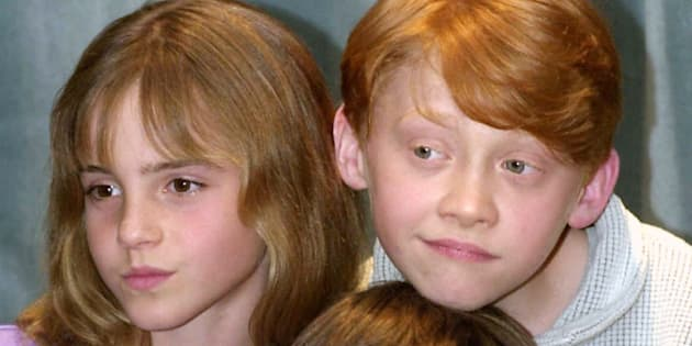 """Actor Daniel Radcliffe (centre), who is to play Harry Potter in the film """"Harry Potter and the Sorcerer's Stone"""" based on the book by J K Rowling, with co-stars Rupert Grint (Ron Weasley) and Emma Watson (Hermione Granger) at the Berkeley Hotel in London."""