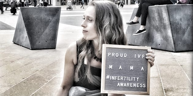 Athena Reich raises awareness in front of Lincoln Center, in New York City.