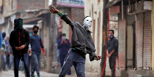 A demonstrator hurls a stone towards the Indian police during an anti-India protest in Srinagar, November 4, 2016.