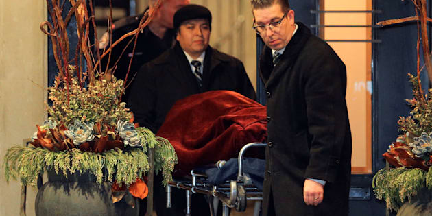 "One of two bodies is removed from the home of billionaire founder of Canadian pharmaceutical firm Apotex Inc., Barry Sherman and his wife Honey, who were found dead under circumstances that police described as ""suspicious"" in Toronto, Ontario, Canada, December 15, 2017. REUTERS/Chris Helgren"