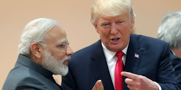 U.S. President Donald Trump chats with Prime Minister Narendra Modi during a working session at the G20 leaders summit in Hamburg, Germany July 8, 2017