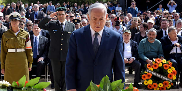 Israeli Prime Minister Benjamin Netanyahu lays a wreath during a ceremony marking the annual Holocaust Remembrance Day at Yad Vashem Holocaust Memorial in Jerusalem on April 12, 2018.  Israelis came to a halt throughout the country to observe two minutes of solemn silence as a siren blared, marking the annual remembrance of the six million Jewish victims of the Holocaust. / AFP PHOTO / DEBBIE HILL        (Photo credit should read DEBBIE HILL/AFP/Getty Images)