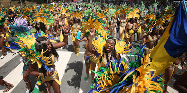 Paraders dance as they make their away around the parade route during the 2015 Caribana Parade at the Exhibition grounds on August 1, 2015.  (Cole Burston/Toronto Star via Getty Images)