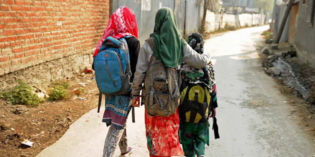 Kashmiri students walk home after attending an ad-hoc learning center on the outskirts of Srinagar.