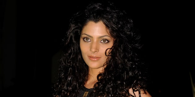 Indian model Saiyami Kher attends the 'Society Young Achiever Awards' 2013 in Mumbai on October 19, 2013.   AFP PHOTO        (Photo credit should read STR/AFP/Getty Images)