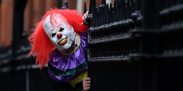 """POSED BY MODEL A person wearing a clown costume in a street in Liverpool. The """"killer clown"""" craze has continued to spread across the UK with one force dealing with 14 reports in 24 hours."""