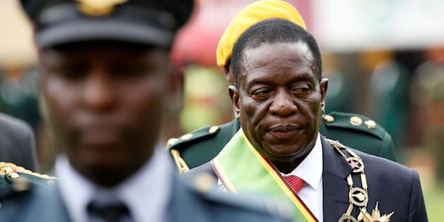 Emmerson Mnangagwa walks after he was sworn in as Zimbabwe's president in Harare, Zimbabwe, November 24, 2017.