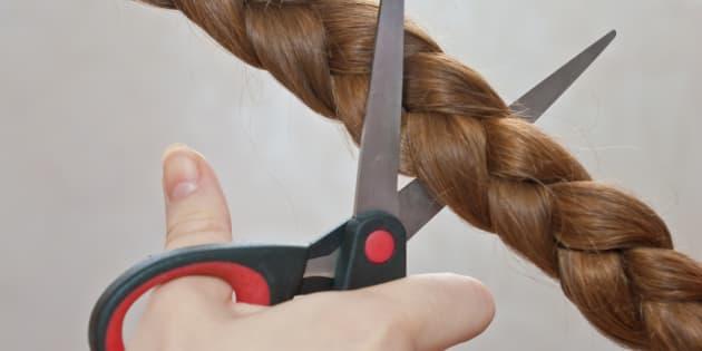 close-up of cutting off a braid