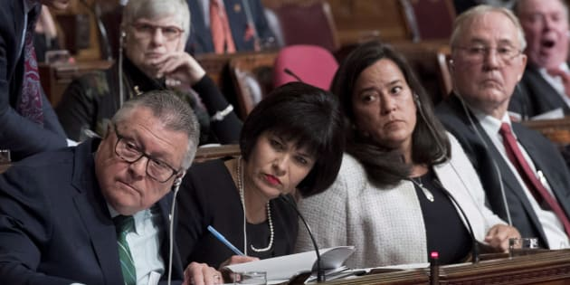 Ministers Ralph Goodale, Ginette Petitpas Taylor, Jody Wilson-Raybould and MP Bill Blair listen during a Senate committee meeting on Parliament Hill in Ottawa on Feb. 6, 2018.