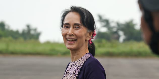 Myanmar State Counselor Aung San Suu Kyi smiles as she walks from a military helicopter after arriving at Sittwe airport on November 2, 2017, following a visit to Maungdaw in Myanmar's Rakhine State.