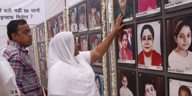 Relatives of the victims who died in a fire at Uphaar cinema hall on the occasion of the 15th anniversary of the tragedy. (Photo by K Asif/India Today Group/Getty Images)