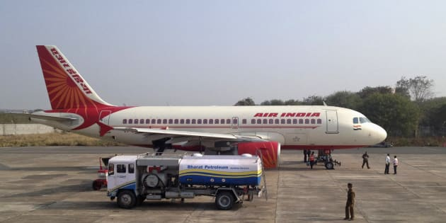 A Bharat Petroleum refuelling vehicle sits on the tarmac next to an Air India A320 aircraft as it refuels the plane with jet fuel in Gwalior February 23, 2012. REUTERS/Vivek Prakash