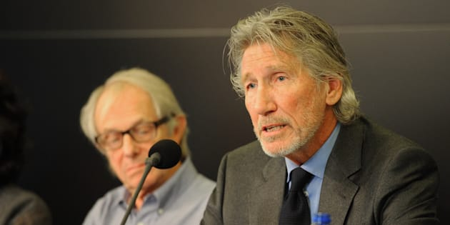English film and television director Ken Loach (L), English musician and co-founder of rock band Pink Floyd Roger Waters (R) attend the Russell Tribunal at the International Press Office in Brussels, Belgium, on Sept. 25, 2014.