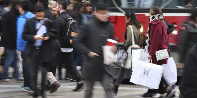 Shoppers outside Toronto's Eaton Centre on Black Friday, Nov. 27, 2015. A new survey of Canadians' financial situations shows a great number will likely take on debt to fund the holiday season, even at a risk to their own mental well-being.