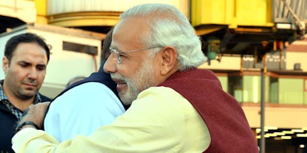 Prime Minister of Pakistan Nawaz Sharif (L) welcomes Indian Prime Minister Narendra Modi (R) at Allama Iqbal International Airport in Lahore, Pakistan on December 25, 2015.